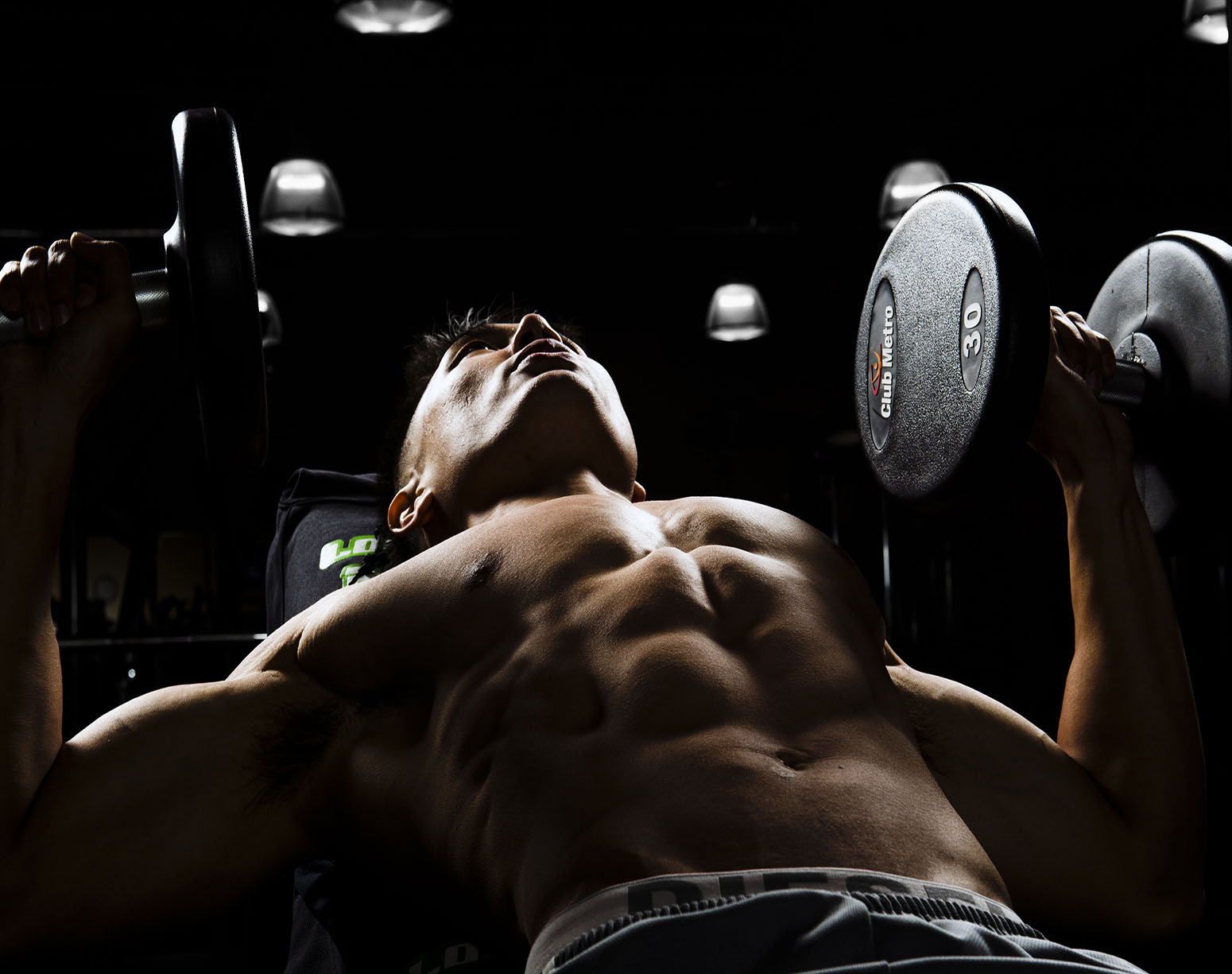 chest-dumbbell-press-guy-personal-training-singapore